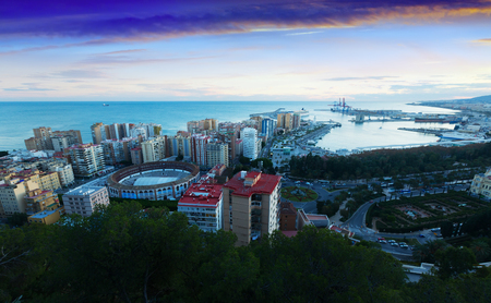 Sunrise view of Malaga with Port and Placa de Torros.  Andalusia, Spain Editorial