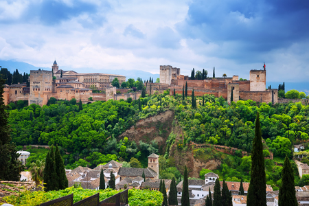Day view of Granada with Alhambra and Sierra Nevada in background. Spain