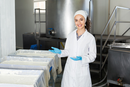 lab coats: Woman in lab coats and gloves on the dairy manufacture