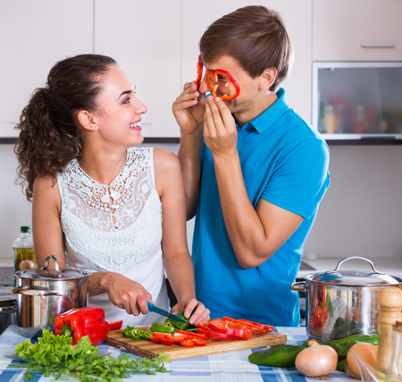 Young husband helping  russian wife to prepare healthy dinner Stock Photo