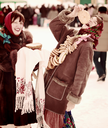 sudarium: Young woman eating pancake during  Shrovetide at Russia
