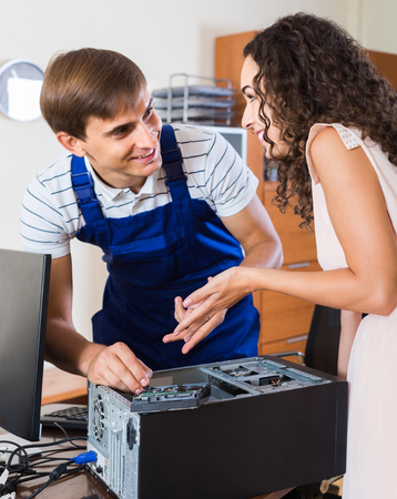 upgrading: Technical engineer upgrading hardware of smiling client computer indoors Stock Photo