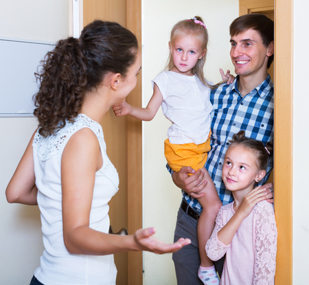 expected: Householder meeting expected happy guests at doorway and smiling