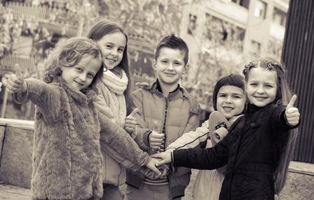 normal school: Friendship forever - outdoor portrait of cheerful junior school kids  together