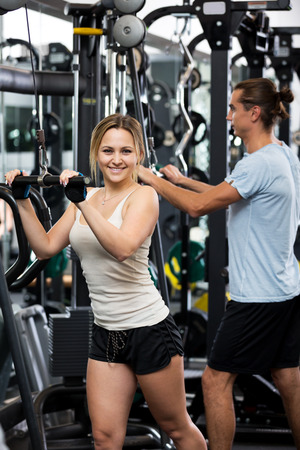 anaerobic: Cheerful active young people having weightlifting training in gym Stock Photo
