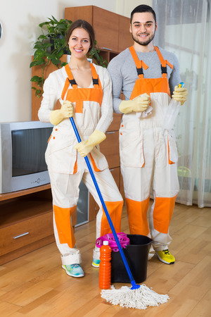 houseman: Portrait of positive smiling professional cleaners team with equipment at the work