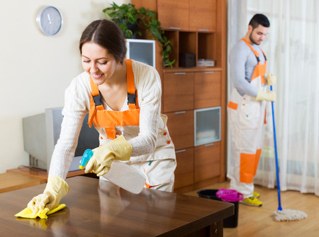 houseman: Cleaning premises positive team is ready to work Stock Photo