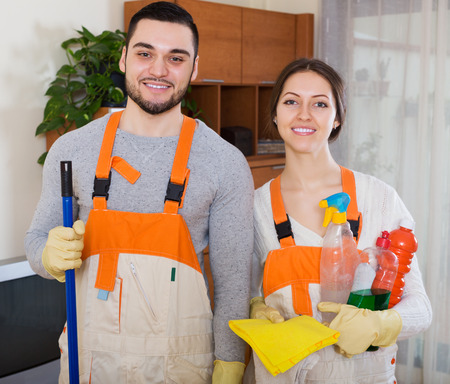 houseman: Portrait of professional cleaners with equipment