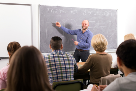 25s: Professor teaching different age students at extension courses Stock Photo