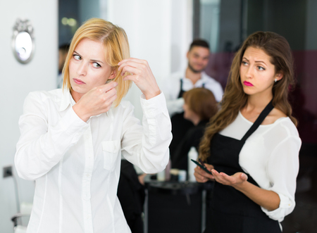 haircutter: Client dissatisfied work of haircutter in the barbershop
