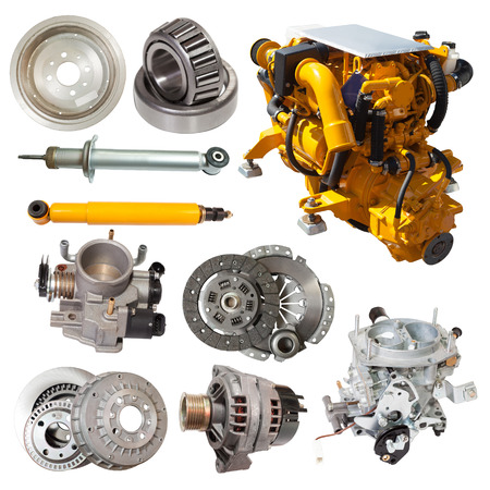 Set of yellow motor and few automotive parts. Isolated over white