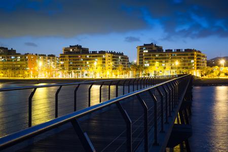 Pier at beach of Badalona  in night time. Catalonia, Spain