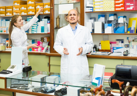 Two positive russian orthopedists working in special store with orthopaedic goods