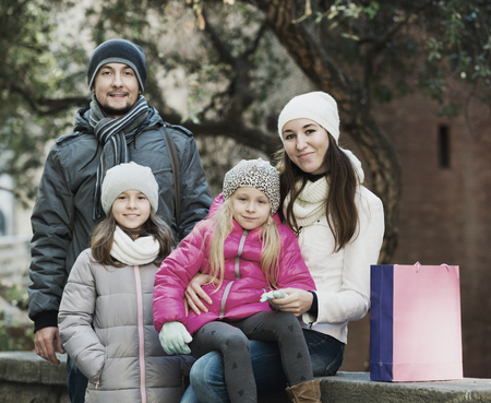 ittle: Winter portrait of happy young adults with little daughters . Focus on woman and ittle girl Stock Photo