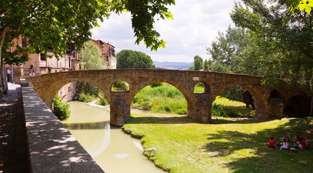 VIC, SPAIN - JUNE 9, 2015: Ancient stone bridge over  river  in Vic.  Spain Stock Photo - 60817315