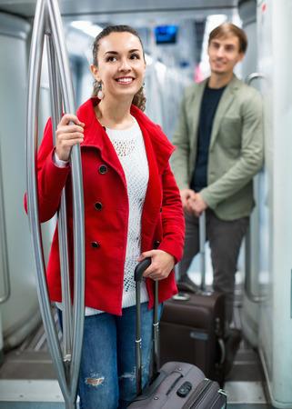 acquaintance: Portrait of  positive people making acquaintance in public transport