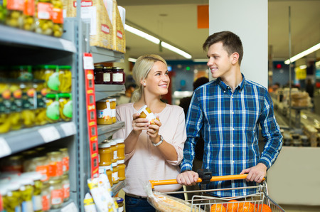 tinned: Positive clients buying tinned food at grocery shop