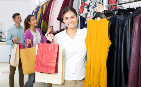 liked: Positive young woman customers chooses liked things in the boutique Stock Photo