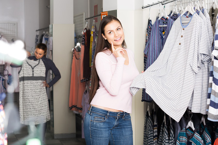 sleepwear: Young women shopping comfortable sleepwear for man in store