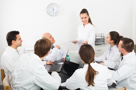 colloquium: Multinational young interns and professor cooperating at hospital meeting Stock Photo