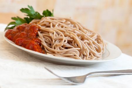 spaghetti pasta with tomato sauce in plate Stock Photo