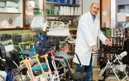 orthopaedic: Doctor posing near display with orthopaedic equipment and machines