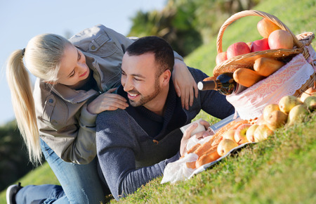 sandwitch: Loving beautiful couple chatting as having picnic in sunny day