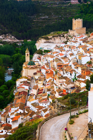 mancha: Day view of Alcala del Jucar with castle