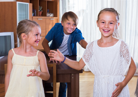 romp: laughing children playing romp game Touch-last at home