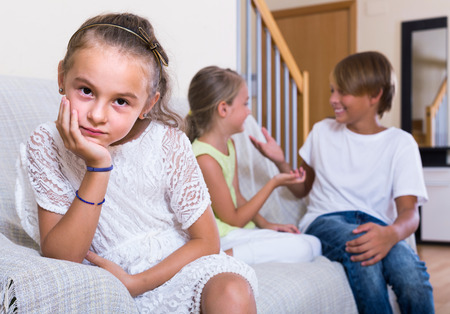 amorousness: First amorousness: offended european  girl and couple of kids apart indoors