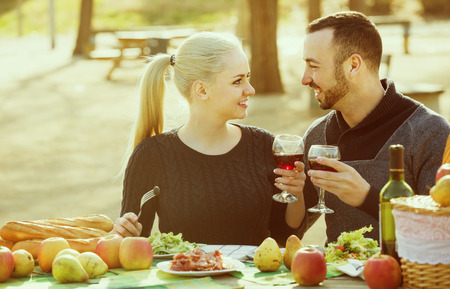 Young american couple having picnic in sunny spring day at countryside Stock Photo