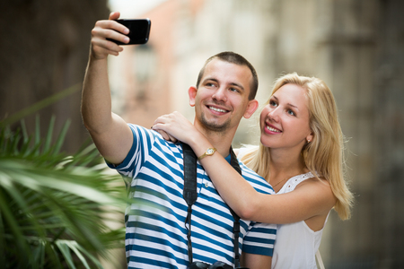 hollidays: Happy european couple taking selfie on summer hollidays in Barcelona city city centre