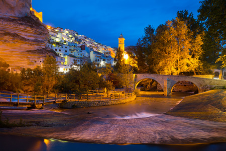 spanish home: night view of Alcala del Jucar with  bridge. Province of Albacete, Spain Stock Photo