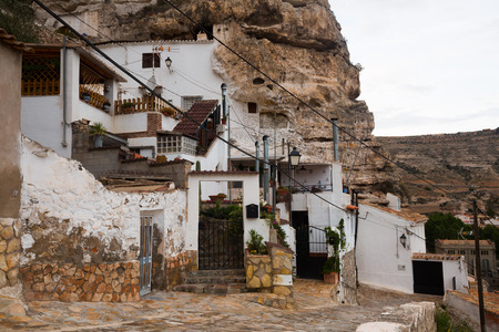 mancha: Dwelling  houses built into rock. Alcala del Jucar.  Province of Albacete, Castile-La Mancha,  Spain
