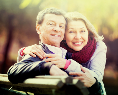Portrait of mature couple spending time outdoors and enjoying together