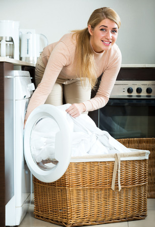 Portrait of beautiful housewife satisfied with quality of washing at home Stock Photo
