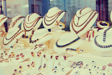 carbuncle: counter with garnet jewelry in store window Stock Photo