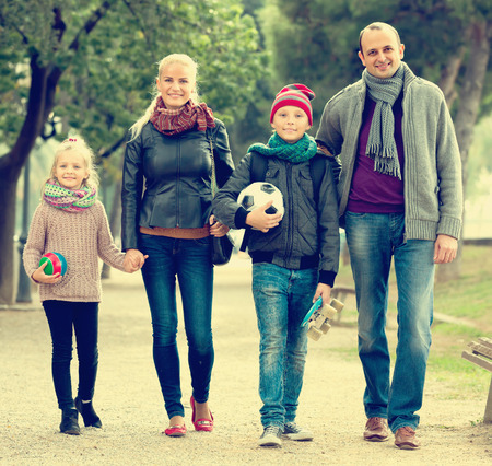 5s: Joyful family with two children spending weekend together outdoors