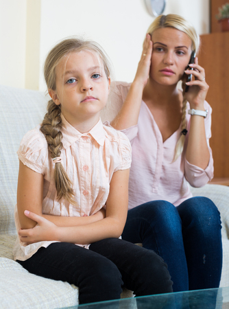 pangs: Stressed mother and little daughter complaining of pain in belly