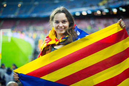 fandom: Excited positive young girl with Catalonia flag rooting for football team