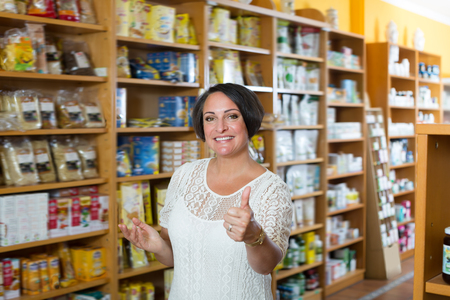 dietary supplements: Portrait of woman in biologically active dietary supplements store Stock Photo