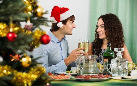 celebrate year: Young family celebrate the New Year at home. Focus on woman Stock Photo