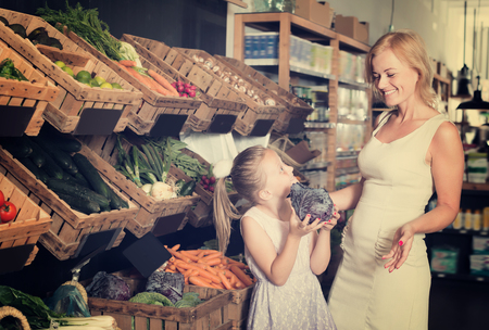 gladly: Portrait of adult woman and girl gladly shopping in supermarket