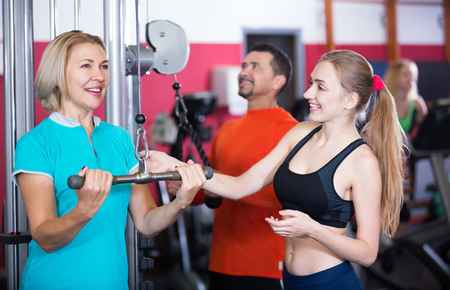anaerobic: Adults of different age training in gym-hall