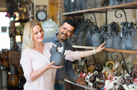 russian man: portrait of happy russian man and woman shopping ceramic utensil in boutique