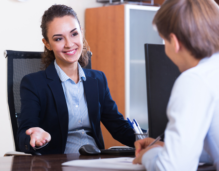 conduction: Young professional teaching new employee in practice Stock Photo