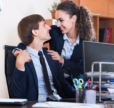 Young top manager flirting with subordinate official at workplace Stock Photo