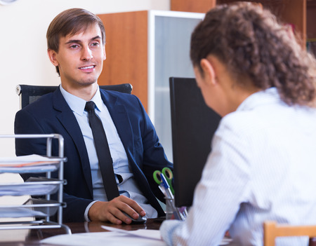 conduction: Potential employee having job interview with clerk in office Stock Photo