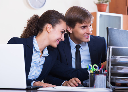 yuppie: Happy young office colleagues successfully working together and smiling