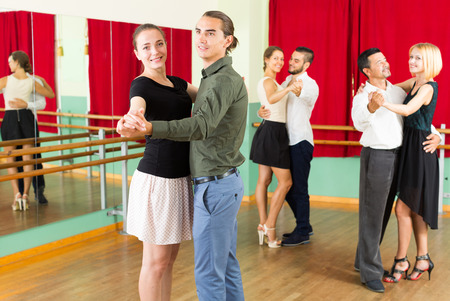 viennese: adults  people having Viennese valse class in studio